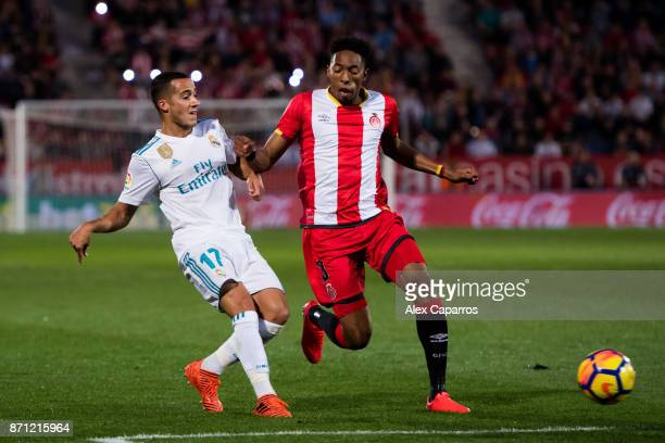 Lucas Vazquez of Real Madrid CF plays the ball past Johan Andres Mojica of Girona FC during the La Liga match between Girona and Real Madrid at...