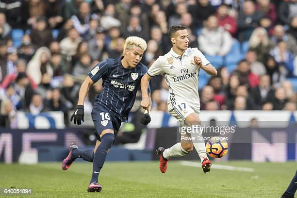 Lucas Vazquez of Real Madrid competes for the ball with Adalberto Penaranda of Malaga CF during their La Liga 201617 match between Real Madrid and...