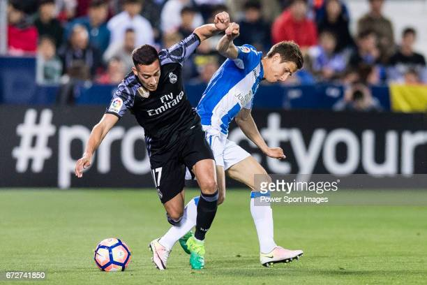 Lucas Vazquez of Real Madrid competes for the ball with Alexander Szymanowski of Deportivo Leganes during their La Liga match between Deportivo...