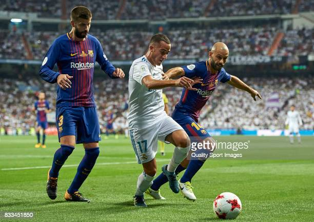 Lucas Vazquez of Real Madrid competes for the ball with Gerard Pique and Javier Mascherano of Barcelona during the Supercopa de Espana Supercopa...