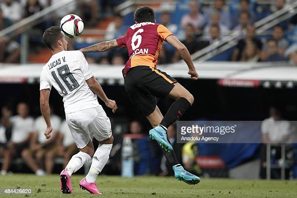 Lucas Vazquez of Real Madrid competes for the ball with Jem Karacan of Galatasaray during the Santiago Bernabeu Trophy match between Real Madrid and...