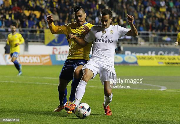 Lucas Vazquez of Real Madrid competes for the ball with Josete Malagon of Cadiz during the Copa del Rey round of 32 first leg match between Cadiz and...