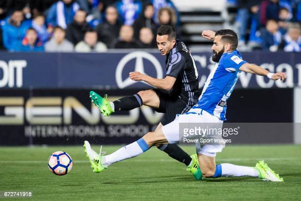 Lucas Vazquez of Real Madrid competes for the ball with Lluis Sastre Reus of Deportivo Leganes during their La Liga match between Deportivo Leganes...