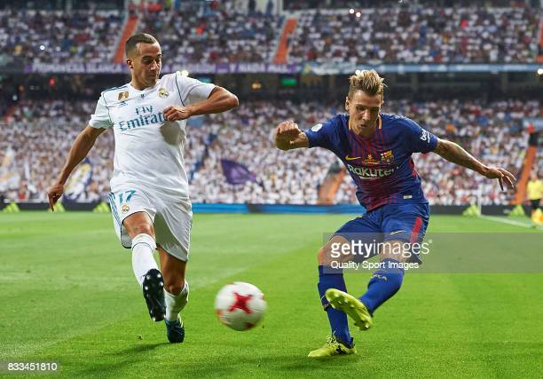 Lucas Vazquez of Real Madrid competes for the ball with Lucas Digne of Barcelona during the Supercopa de Espana Supercopa Final 2nd Leg match between...
