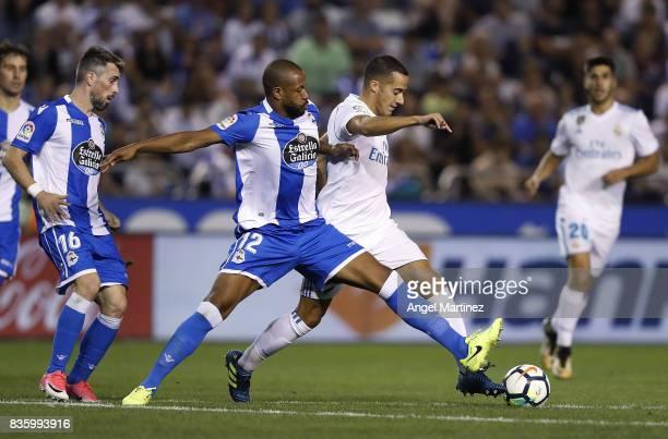 Lucas Vazquez of Real Madrid competes for the ball with Sidnei Da Silva of Deportivo La Coruna during the La Liga match between Deportivo La Coruna...