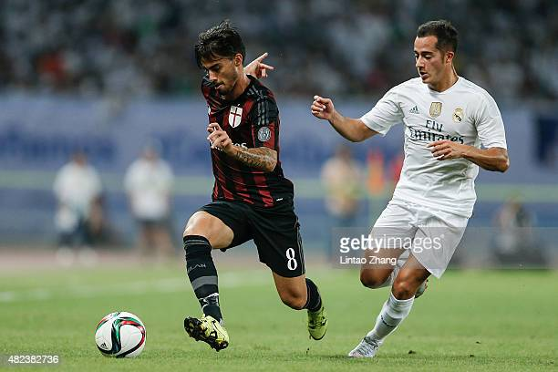 Lucas Vazquez of Real Madrid contests the ball against Suso of AC Milan during the International Champions Cup match between Real Madrid and AC Milan...