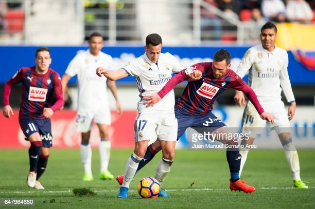 Lucas Vazquez of Real Madrid duels for the ball with Anaitz Arbilla of SD Eibar during the La Liga match between SD Eibar and Real Madrid at Ipurua...