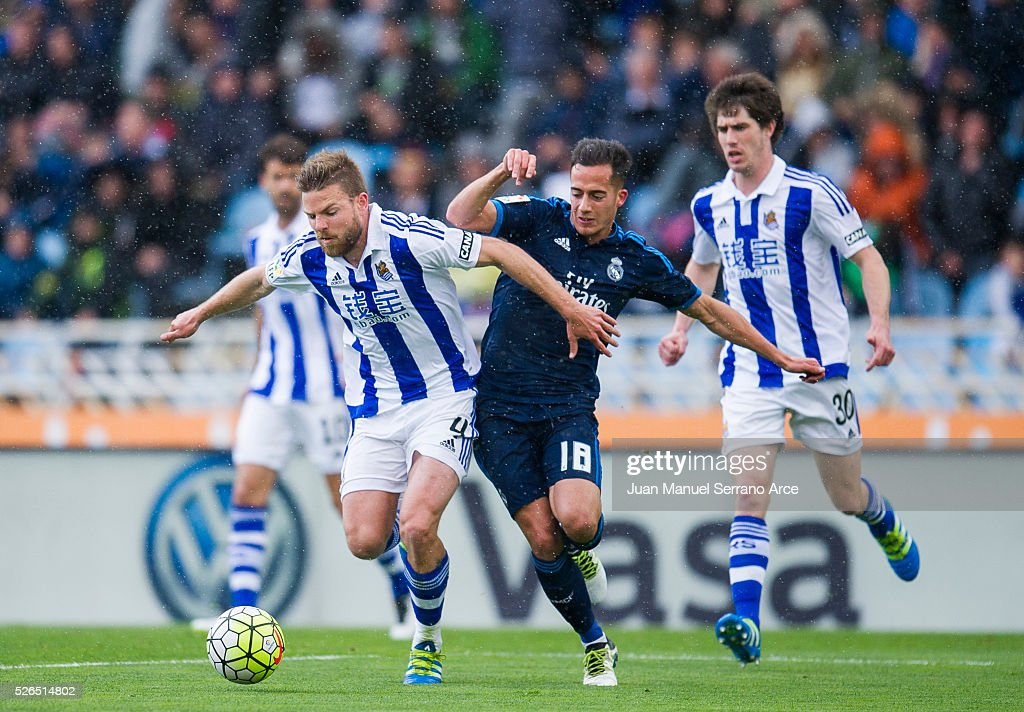 Lucas Vazquez of Real Madrid duels for the ball with Asier Illarramendi of Real Sociedad during the La Liga match between Real Sociedad de Futbol and Real Madrid at Estadio Anoeta on April 30, 2016 in San Sebastian, Spain.