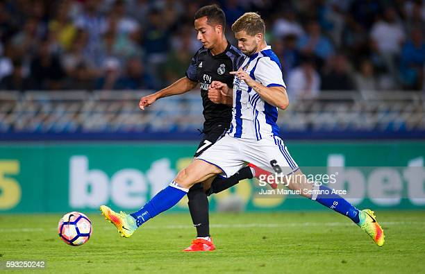 Lucas Vazquez of Real Madrid duels for the ball with Inigo Martinez of Real Sociedad during the La Liga match between Real Sociedad de Futbol and...