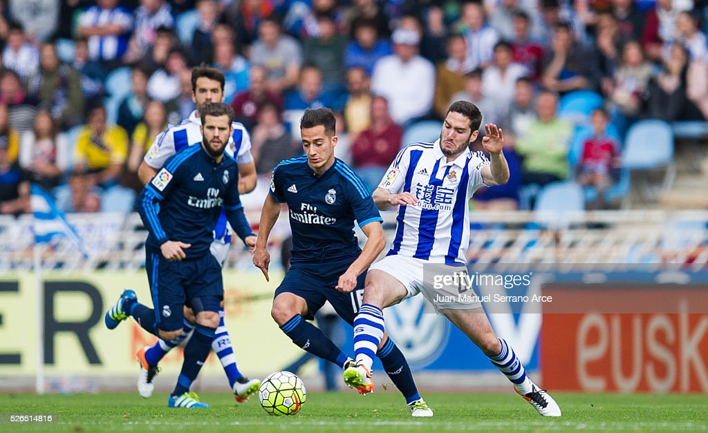 Lucas Vazquez of Real Madrid duels for the ball with Joseba Zaldua of Real Sociedad during the La Liga match between Real Sociedad de Futbol and Real Madrid at Estadio Anoeta on April 30, 2016 in San Sebastian, Spain.