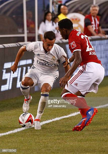 Lucas Vazquez of Real Madrid fights for the ball with David Alaba of Bayern Munich during their International Champions Cup match at MetLife Stadium...