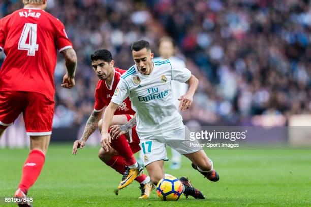 Lucas Vazquez of Real Madrid fights for the ball with Ever Maximiliano Banega of Sevilla FC during the La Liga 201718 match between Real Madrid and...