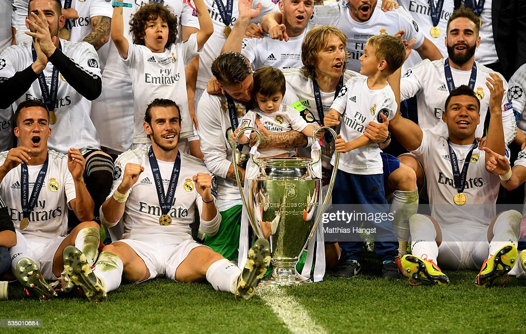Lucas Vazquez of Real Madrid, <a gi-track='captionPersonalityLinkClicked' href=/galleries/search?phrase=Gareth+Bale&family=editorial&specificpeople=609290 ng-click='$event.stopPropagation()'>Gareth Bale</a> of Real Madrid, Sergio Ramos of Real Madrid, <a gi-track='captionPersonalityLinkClicked' href=/galleries/search?phrase=Luka+Modric&family=editorial&specificpeople=560350 ng-click='$event.stopPropagation()'>Luka Modric</a> of Real Madrid and <a gi-track='captionPersonalityLinkClicked' href=/galleries/search?phrase=Casemiro&family=editorial&specificpeople=7150894 ng-click='$event.stopPropagation()'>Casemiro</a> of Real Madrid pose with the Champions League trophy after the UEFA Champions League Final match between Real Madrid and Club Atletico de Madrid at Stadio Giuseppe Meazza on May 28, 2016 in Milan, Italy.