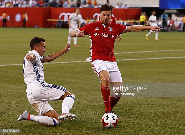 Lucas Vazquez of Real Madrid guards Xabi Alonso of Bayern Munich during their International Champions Cup match at MetLife Stadium on August 3 2016...