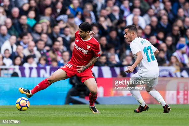 Lucas Vazquez of Real Madrid in action against Ever Banega of Sevilla FC during the La Liga 201718 match between Real Madrid and Sevilla FC at...