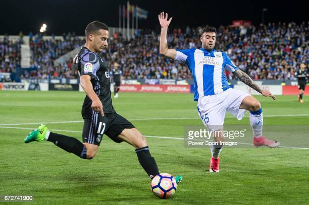 Lucas Vazquez of Real Madrid is challenged by Diego Rico of Deportivo Leganes during their La Liga match between Deportivo Leganes and Real Madrid at...