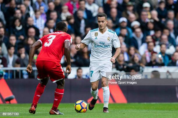 Lucas Vazquez of Real Madrid is tackled by Lionel Jules Carole of Sevilla FC during the La Liga 201718 match between Real Madrid and Sevilla FC at...