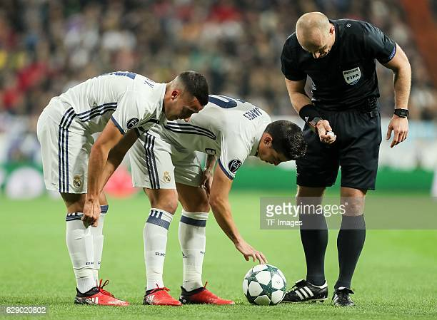 Lucas Vazquez of Real Madrid James Rodriguez of Real Madrid and referee Szymon Marciniak looks on during the UEFA Champions League match between Real...