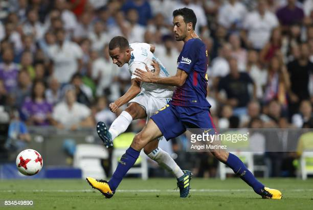 Lucas Vazquez of Real Madrid shoots on goal past Sergio Busquets of FC Barcelona during the Supercopa de Espana Final second leg match between Real...