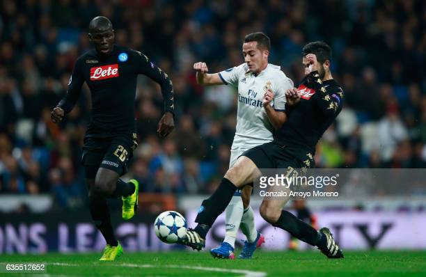 Lucas Vazquez of Real Madrid takes on Raul Albiol and Kalidou Koulibaly of Napoli during the UEFA Champions League Round of 16 first leg match...