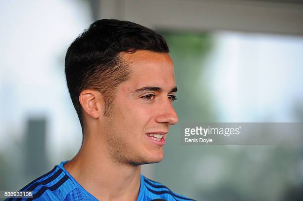 Lucas Vazquez of Real Madrid talks to members of the press at the mixed zone after the team training session at the Real Madrid Open Media Day ahead...