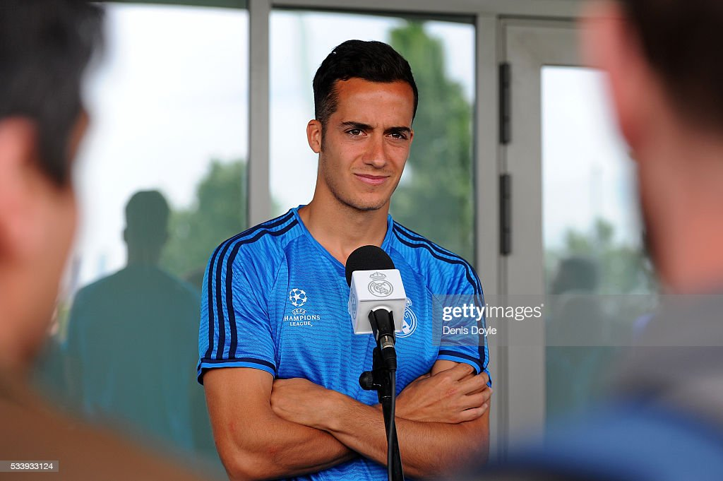 Lucas Vazquez of Real Madrid talks to members of the press at the mixed zone after the team training session at the Real Madrid Open Media Day ahead of the UEFA Champions League Final against Club Atletico Madrid at Valdebebas training ground on May 24, 2016 in Madrid, Spain.