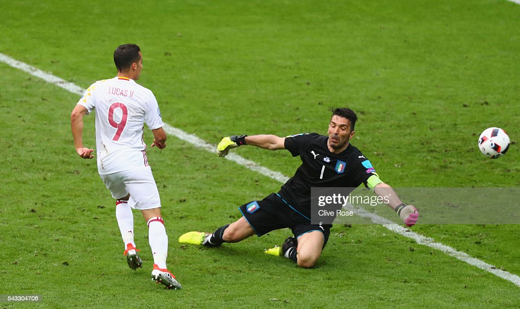 Graziano Pelle of Italy shoots at goal while <a gi-track='captionPersonalityLinkClicked' href=/galleries/search?phrase=Gianluigi+Buffon&family=editorial&specificpeople=208860 ng-click='$event.stopPropagation()'>Gianluigi Buffon</a> of Italy tries to save during the UEFA EURO 2016 round of 16 match between Italy and Spain at Stade de France on June 27, 2016 in Paris, France.