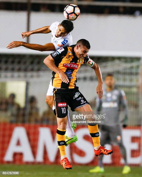 Lucas Verissimo of Santos and Pablo Escobar of The Stronguest in action during the match between Santos of Brazil and The Strongest of Bolivia for...