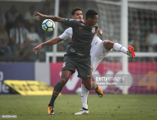 Lucas Verissimo of Santos battles for the ball with Jo of Corinthians during the match between Santos and Corinthians as a part of Campeonato...