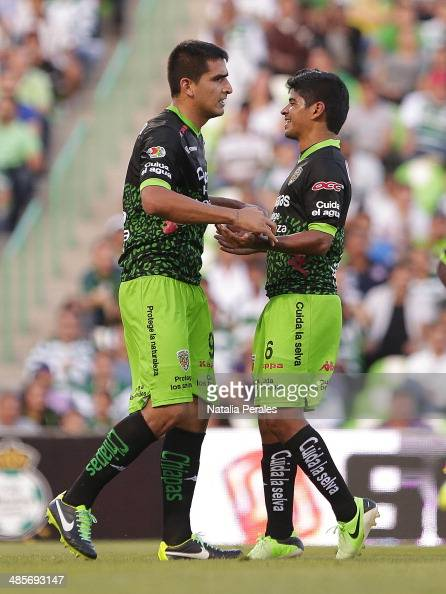 Lucas Viatri of Jaguares celebrates the first goal of his team with Luis Robles during a match between Santos Laguna and Chiapas as part of round...