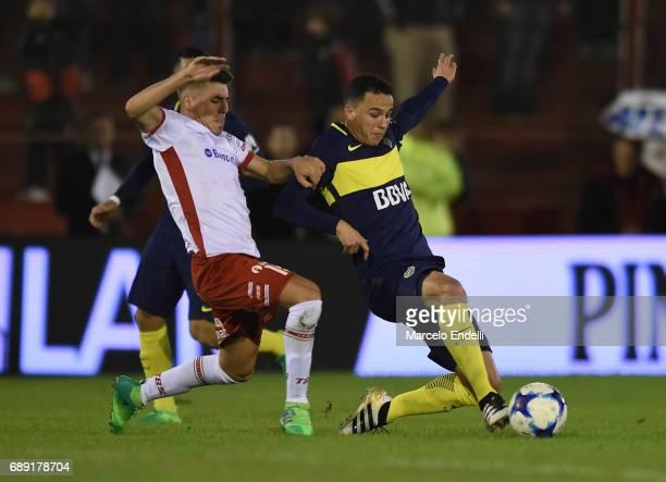 Lucas Villalba of Huracan fights for ball with Leonardo Jara of Boca Juniors during a match between Huracan and Boca Juniors as part of Torneo...