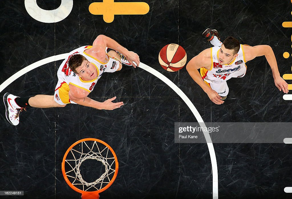 Lucas Walker and Chris Goulding of the Tigers look to rebound the ball during the round 20 NBL match between the Perth Wildcats and the Melbourne Tigers at Perth Arena on February 21, 2013 in Perth, Australia.