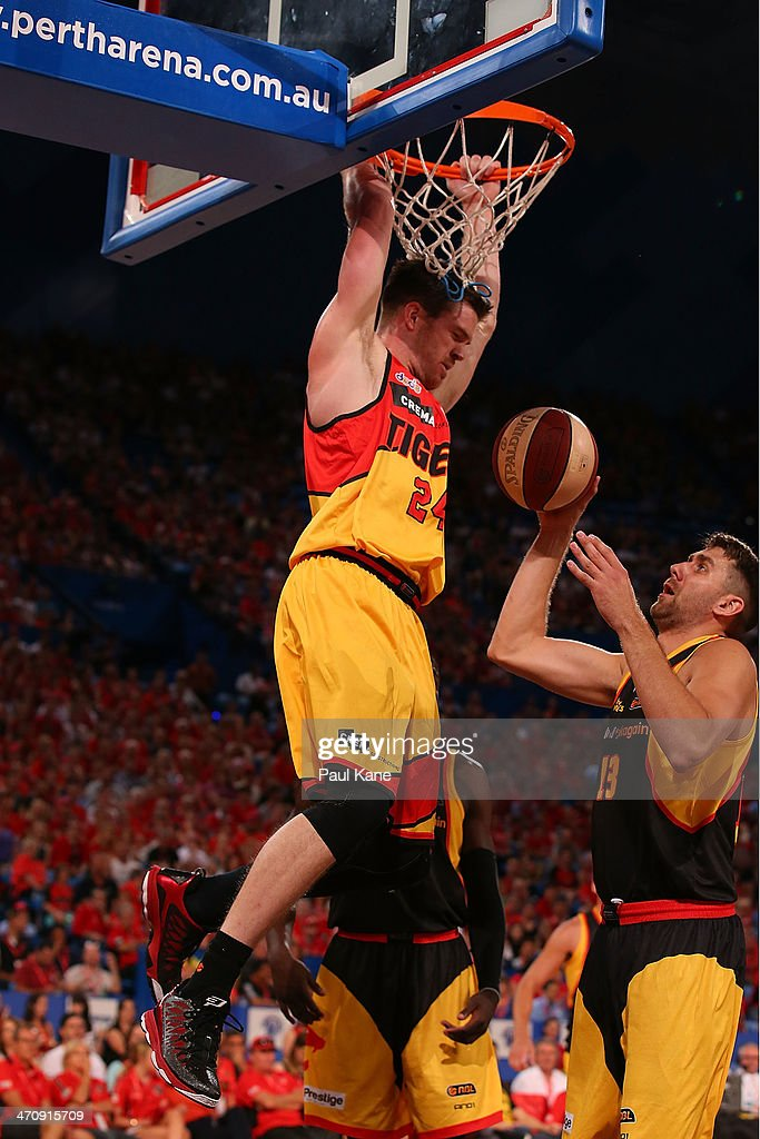 Lucas Walker of the Tigers dunks the ball during the round 19 NBL match between the Perth Wildcats and the Melbourne Tigers at Perth Arena on February 21, 2014 in Perth, Australia.