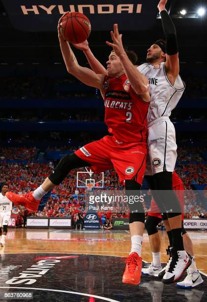 Lucas Walker of the Wildcats pulls down a rebound against Josh Boone of United during the round three NBL match between the Perth Wildcats and...