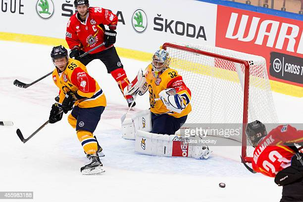 Lucas Wallmark of Lulea Hockey scores against Oskari Setanen Goaltender of Lukko Rauma during the Champions Hockey League group stage game between...