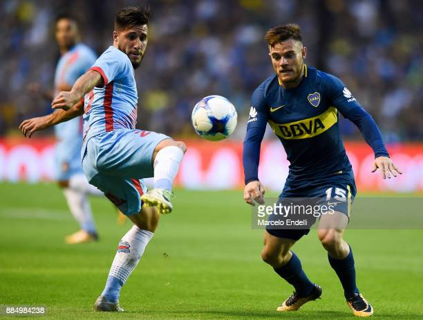 Lucas Wilchez of Arsenal fights for ball with Nahitan Nandez of Boca Juniors during a match between Boca Juniors and Arsenal as part of the Superliga...