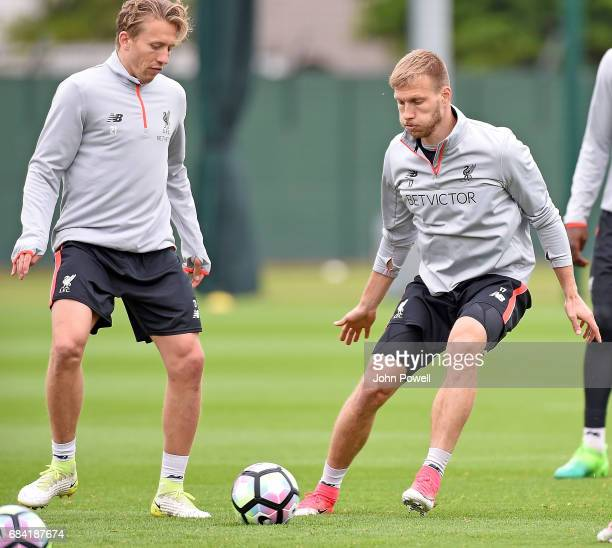 Lucas with Ragnar Klavan of Liverpool during a training session at Melwood Training Ground on May 17 2017 in Liverpool England