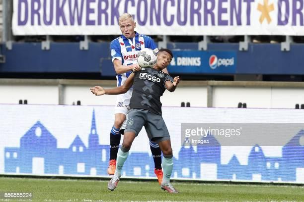 Lucas Woudenberg of sc Heerenveen David Neres of Ajax during the Dutch Eredivisie match between sc Heerenveen and Ajax Amsterdam at Abe Lenstra...