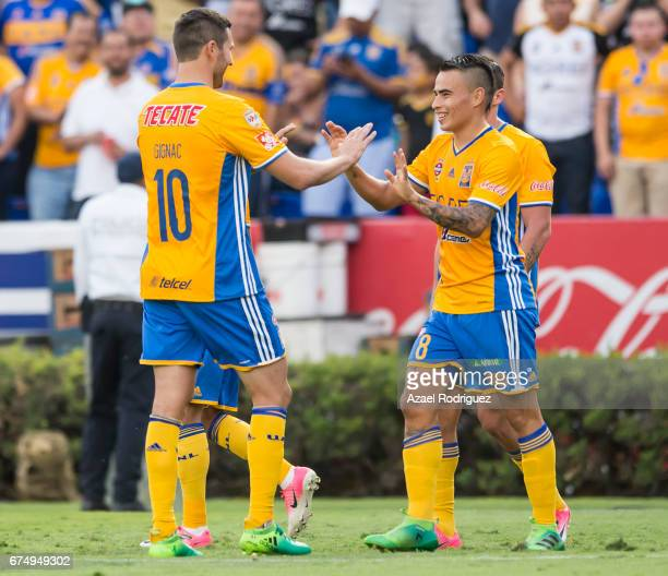 Lucas Zelarayan of Tigres celebrate with teammate Andre Gignac after scoring his team's second goal during the 16th round match between Tigres UANL...