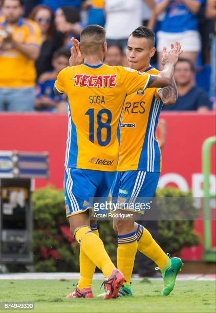 Lucas Zelarayan of Tigres celebrate with teammate Ismael Sosa after scoring his team's second goal during the 16th round match between Tigres UANL...