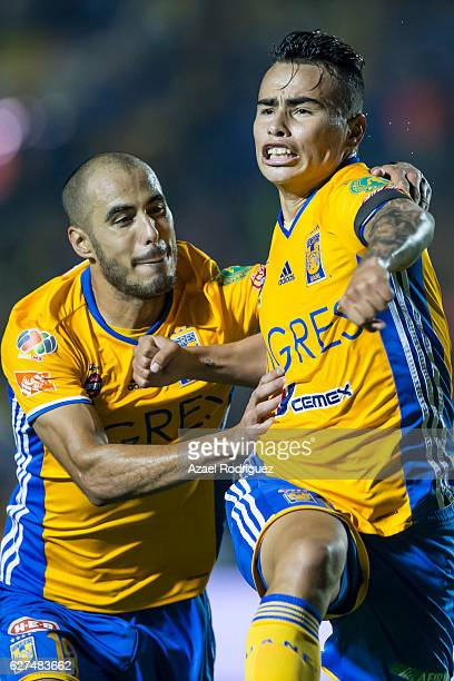 Lucas Zelarayan of Tigres celebrates with teammate Guido Pizarro after scoring his team's second goal during the semifinals second leg match between...