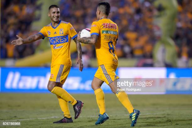 Lucas Zelarayan of Tigres celebrates with teammate Ismael Sosa after scoring his team's first goal during the 3rd round match between Tigres UANL and...