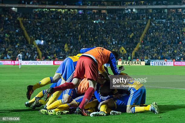 Lucas Zelarayan of Tigres celebrates with teammates after scoring his team's second goal during the semifinals second leg match between Tigres UANL...