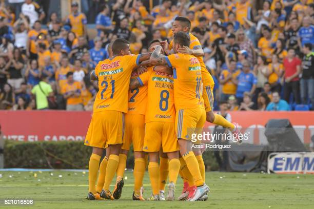 Lucas Zelarayan of Tigres celebrates with teammates after scoring his team's first goal during the 1st round match between Tigres UANL and Puebla as...