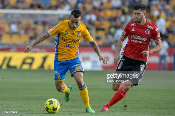 Lucas Zelarayan of Tigres defends the ball from Guido Rodriguez of Tijuana during the 16th round match between Tigres UANL and Tijuana as part of the...