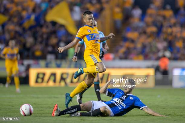 Lucas Zelarayan of Tigres fights for the ball with Hiram Mier of Queretaro during the 3rd round match between Tigres UANL and Puebla as part of the...