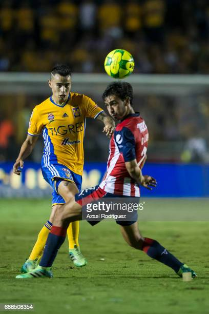 Lucas Zelarayan of Tigres fights for the ball with Oswaldo Alanis of Chivas during the Final first leg match between Tigres UANL and Chivas as part...