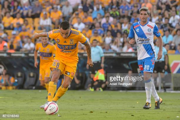 Lucas Zelarayan of Tigres kicks the ball and scores his team's first goal during the 1st round match between Tigres UANL and Puebla as part of the...