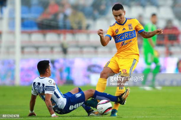 Lucas Zelarayan of Tigres struggles for the ball with Emmanuel Garcia of Pachuca during the 4th round match between Pachuca and Tigres UANL as part...