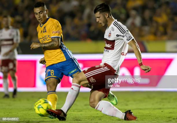 Lucas Zelayaran off Tigres defends against Guido Rodriguez of Tijuana during the semi finals first leg match between Tigres UANL and Tijuana as part...